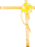 Yellow bow with yellow ribbon as a decoration for a gift Stock Photos
