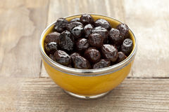 Yellow bowl with black olives Stock Photography
