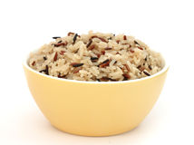 Yellow bowl with cooked rice of various types Stock Photos