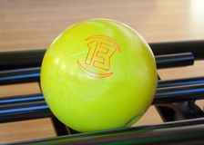 Yellow bowling ball number thirteen Royalty Free Stock Photo