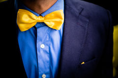 Yellow bowtie, handsome outfit. Yellow bowtie decorates a handsome outfit Royalty Free Stock Photography