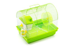 A yellow box in a small yellow hamster cage. Royalty Free Stock Images