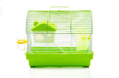 A yellow box in a small yellow hamster cage. Royalty Free Stock Photography