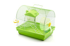 A yellow box in a small yellow hamster cage. Stock Photography