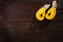 Yellow boxing gloves Stock Images