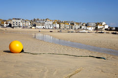 Yellow boy at low tide. Yellow boy at low tide on St. Ives harbour beach Stock Image