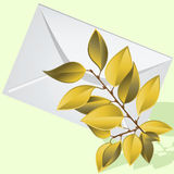 The yellow branch lies on an envelope. Stock Photo
