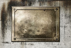 Yellow brass metal plate border. Brass yellow metal plate on grungy concrete background texture Stock Photos