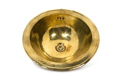 Yellow brass round sink on white background. Isolated golden sink in retro style. Antique sink for home on white background royalty free stock image