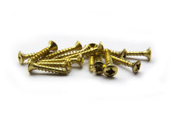 Yellow Brass Screws With a Philips Crosshead Royalty Free Stock Photos