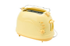 Yellow bread toaster. A cute yellow bread toaster, the kitchenware you need for breakfast Royalty Free Stock Photography