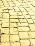Yellow brick road. Cobblestone pattern with yellow shade Royalty Free Stock Image