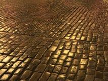 Yellow Brick Road. Golden color cobblestone in Old Town Riga Latvia stock image