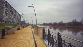 A yellow brick road. Walking along Pregel river in Kaliningrad stock photo