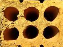 Yellow Brick Six Holes Stock Images