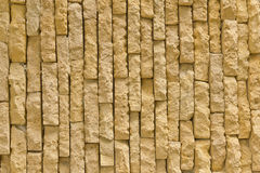 The yellow brick wall. The wall of yellow sandstone stock images