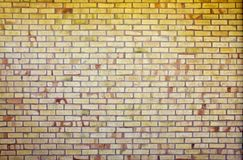 Yellow brick wall, backgroud and texture. Brick masonry horizontal color technology architecture wallpaper. Texture of a yellow brick wall background in the stock photography