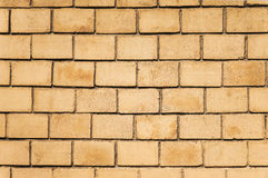 Yellow brick wall background. Close up Stock Images