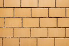 Yellow brick wall. Background close up Stock Images