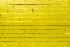 Yellow Brick Wall. Background pattern texture made from a bright yellow brick wall. Traditional masonry work Stock Photos