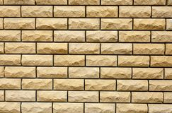 Yellow brick wall, background, place for text royalty free stock image