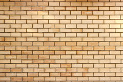 Yellow brick wall background. Yellow smooth brick wall background texture Stock Photos