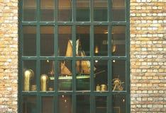 Yellow brick wall with a big window and model sailing ship insid Royalty Free Stock Image