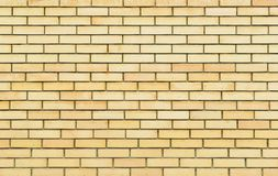 Yellow brick wall, brickwork texture, background Stock Image