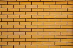Yellow brick wall. Yellow color photo of a brick close up on the wall Royalty Free Stock Photo