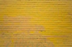 Yellow brick wall stock image
