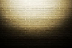 Yellow brick wall with light effect and shadow, abstract background photo Royalty Free Stock Images