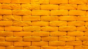 Yellow brick wall with lighting. Are decorated in the old house stock image