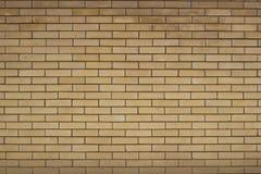 Yellow brick wall. Masonry of ornamental yellow brick Royalty Free Stock Photos