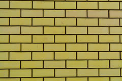 Yellow brick wall. In a newly built house Stock Image