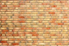 Yellow brick wall with red bricks. Texture Royalty Free Stock Photo