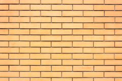 Yellow brick wall. Textural background. New yellow brick wall. Textural background Stock Photo