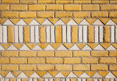 Yellow brick wall texture with ornament pattern Stock Photo