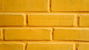 Yellow brick wall Stock Images