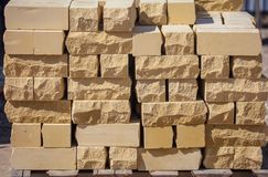 Yellow bricks on the construction site as a building material.  Royalty Free Stock Photo