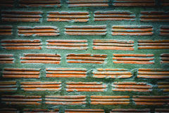 Yellow bricks and green cement wall background and texture. Royalty Free Stock Photo