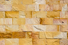Yellow brickwall modern rock texture Royalty Free Stock Photo
