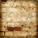 Yellow brickwork as a grunge wallpaper background Royalty Free Stock Photo