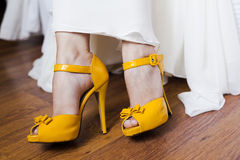 Yellow brides shoes. Yellow  brides shoes on closeup Stock Photo