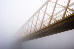 Yellow bridge in the fog Stock Images
