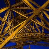 The yellow bridge lanterns illuminated by a steel bridge farm against a dark blue evening sky. Stock Photography