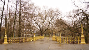 Yellow bridge in the park Stock Images