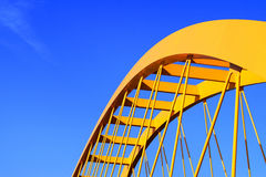 Yellow bridge. Yellow steel bridge and a blue sky Stock Photo