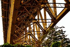 Yellow bridge from underneath. While on a hike I walked under this yellow bridge and loved the angles as well as the tree underneath stock photography