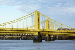 Yellow bridges over the Allegheny River in Pittsburgh, Pennsylvania stock images