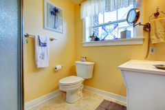 Yellow bright bathroom Stock Photos